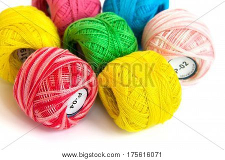 Multicolored skeins of yarn lined in the form of a flower. View in the left corner.