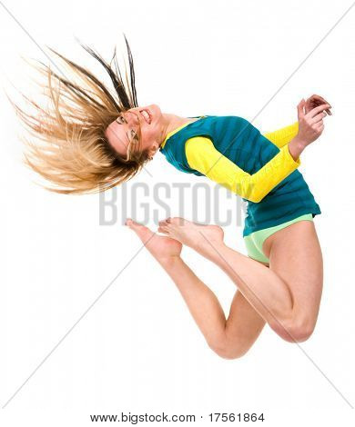 Young attractive blond jumping with hair flying