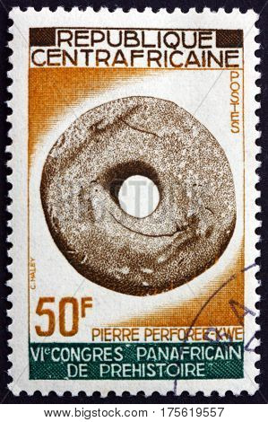 CENTRAL AFRICAN REPUBLIC - CIRCA 1967: a stamp printed in Central African Republic shows Pierced stone Kwe tribe circa 1967