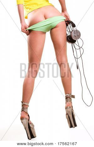 Sexy girl with headphones pulling panties off