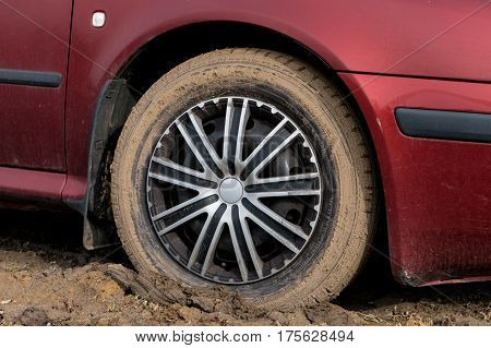 SENOV CZECH REPUBLIC - MARCH 3: Detail of a dirty tyre of a normal family car on a muddy road. Image demonstrating difficulties when the road was being reconstructed was taken on March 3 2017.