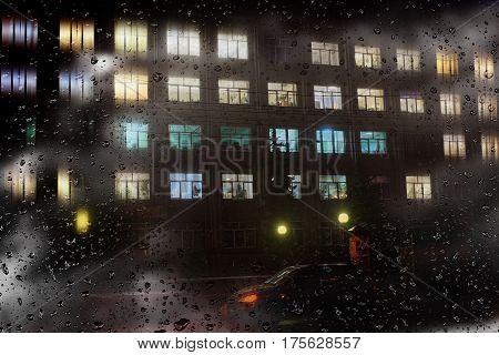 Windows night city in the rainy rainy weather