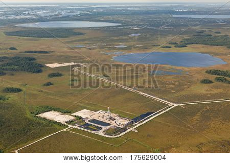 Aerial view of oil rig at an oil field in Western Siberia in the autumn