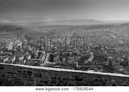 Amazing black and white aerial view of the city Deva from the wall of fortress