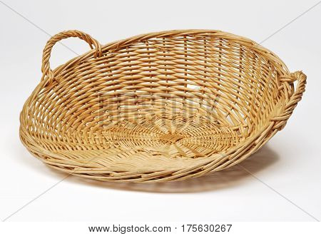 Empty wicker basket for buffet table on white background