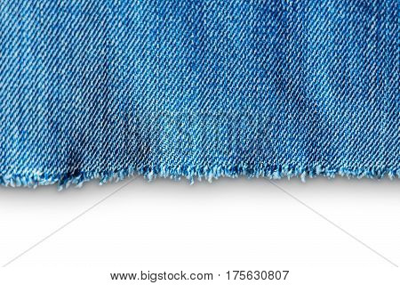 Untreated edge of jeans clothes isolated on white background. Element of jeans clothes as blank for backdrop