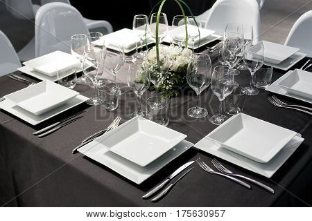 Elegant Table set for feast with square plate