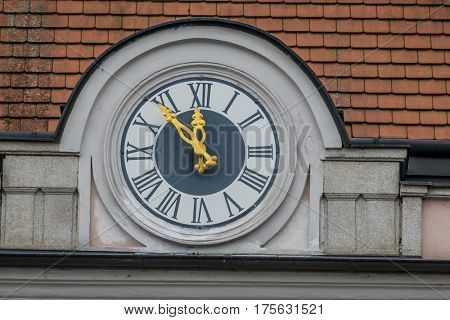 clock on the facade