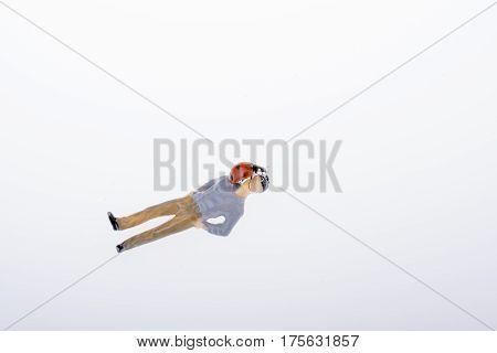 Beautiful Red Ladybug Walking On Body Of Figurine Man