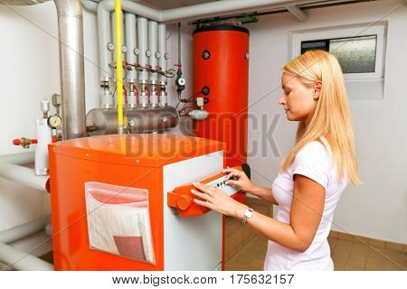 woman at heating in the boiler room