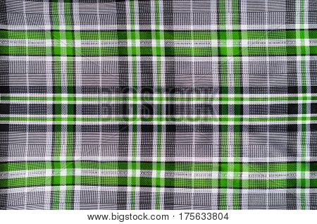 Fabric for clothing background. Grey and green cloth in a cage as blank backdrop