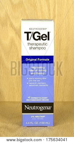 RIVER FALLS,WISCONSIN-MARCH 09,2017: A box of T/Gel brand therapeutic shampoo with a wood background.
