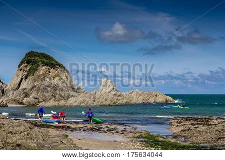 Lee Bay on the north coast of Devon. A group of kayakers are preparing to sail. England