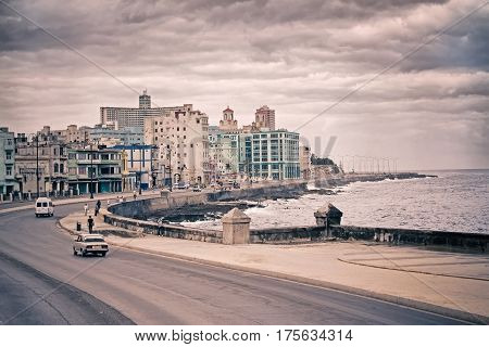 Toned Cuba capital cityscape from Havana Malecon