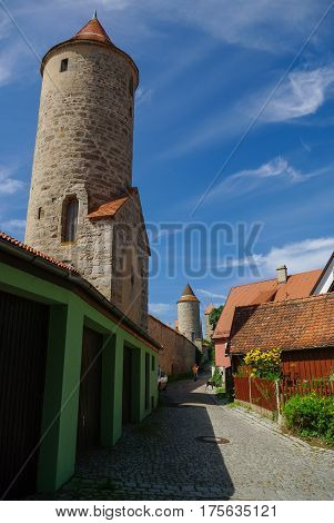 City Walls And Towers Of Dinkelsbuhl, One Of The Archetypal Medieval Towns On The German Romantic Ro