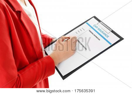 Insurance agent filling claim form on white background