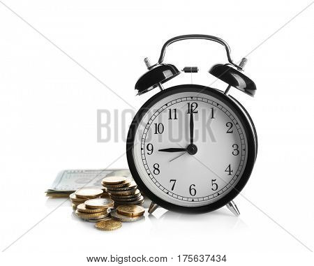 Alarm clock and money on white background