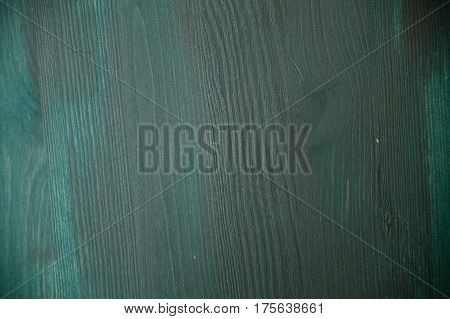Blue wood texture. Blue wood background. Blue wood table. Close up view of blue wood texture and background. Abstract background and texture for designers. Blue and green texture.