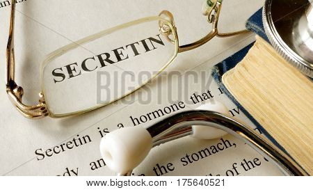 Secretin written on a paper. Hormones concept.