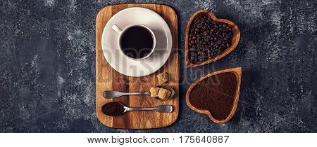 Coffee Cup, Beans And Ground Powder On Stone Background.