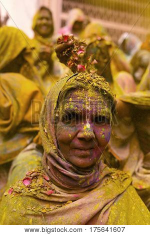 Vrindavan, India - March 21, 2016: An Indian widow celebrating Holi, the Hindu spring festival of colours, at Gopinath Temple in Vrindavan, Uttar Pradesh, India.