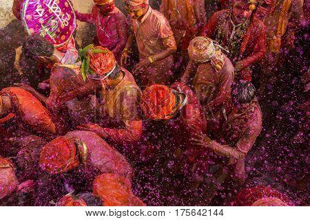 Nandgaon, India - March 18, 2016: Barsana villagers come to Nandgaon village to celebrate Lathmar Holi in Nandgaon, Uttar Pradesh, India.