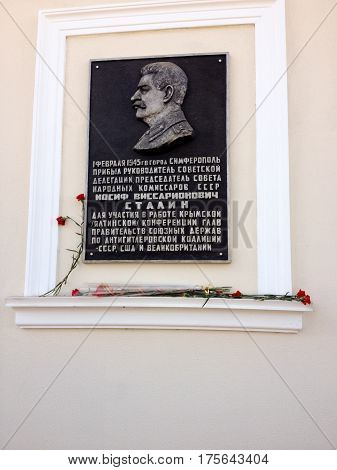 SIMFEROPOL CRIMEA UKRAINE - FEB 28 2017: Memorial plaque in honor of Stalin on main office of Communist Party of Russian Federation CPRF in Simferopol Crimea Ukraine on Feb 28 2017.