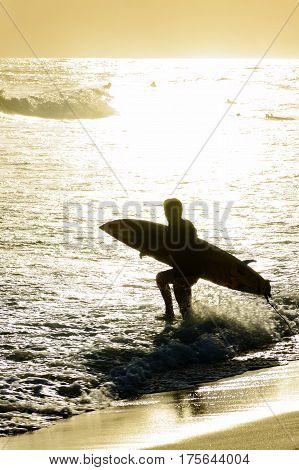Summer sunset with surfers at Ipanema beach in Rio de Janeiro