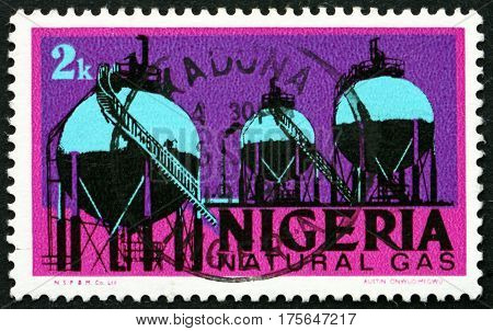 NIGERIA - CIRCA 1974: a stamp printed in Nigeria shows Natural gas tanks industry circa 1974