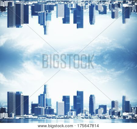 Abstract upside down city on clear sky background. Copy space