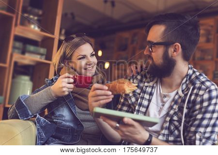 Two people sitting in a cafe having breakfast and enjoying a time spent with each other