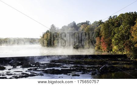 Steaming water in early morning light in the Fall in NY