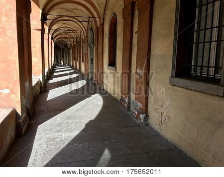 BOLOGNA - MARCH 7, 2017: Interior view inside the Portico di San Luca, a monumental roofed arcade connecting Porta Saragozza with the San Luca Sanctuary, on Colle della Guardia in Bologna, Italy.