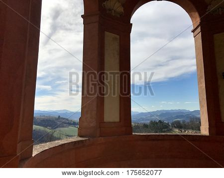 BOLOGNA - MARCH 7, 2017: Scenic view of rural mountainous countryside of the Emilia-Romagna region a window from the San Luca Sanctuary, on Colle della Guardia in Bologna, Italy.