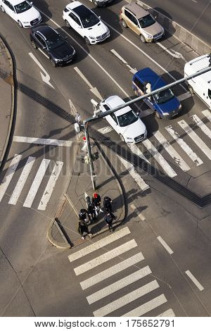 Prague, Czech Republic - March 3: Bird's Eye View Of Cars Crossing Intersection With People Walking