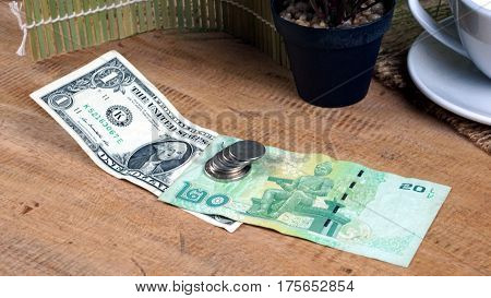 US dollars bill and Thai baht banknote. Currency foreign exchange. Business and Financial or money management for investments.