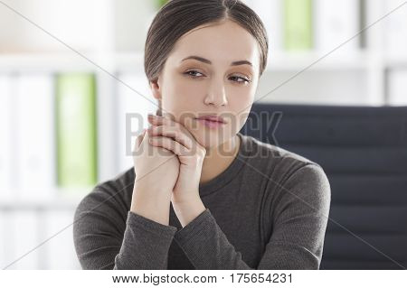 Depressed Woman At Her Workplace