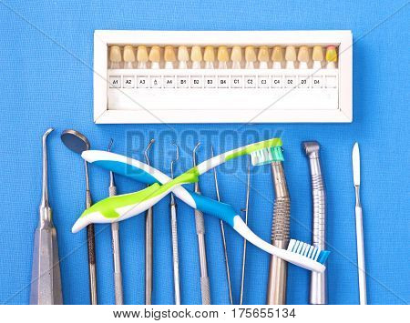 The dental instrument lies on the table. View from above.