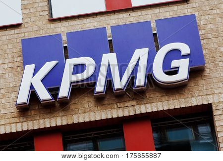 Falun Sweden - September 29 2016: Closeup of the auditing and accounting comapany KPMG logo and sign on its branch office located in Falun.