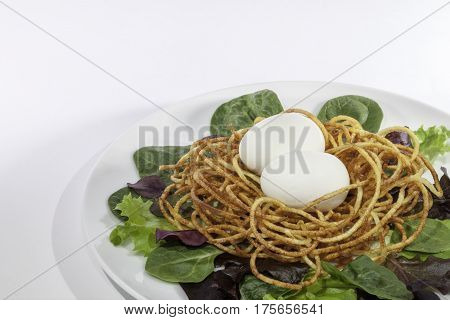 Healthy free range hen's egg salad with spiralized potato nest.