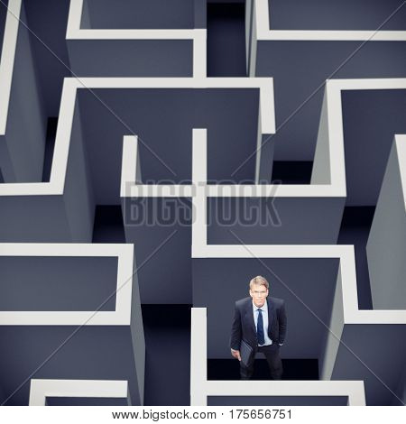 businessman standing in the middle of a maze
