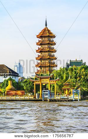 The Chinese style Chee Chin Khor pagoda at the Chao Praya river side in Thonburi, Bangkok