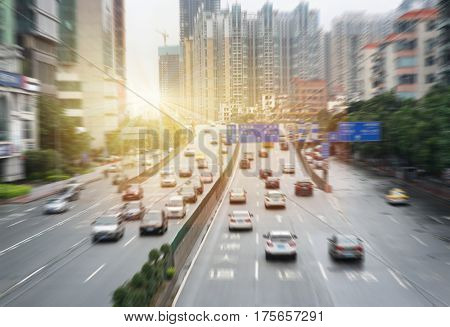 modern city evening sunset highway traffic skyline buildings