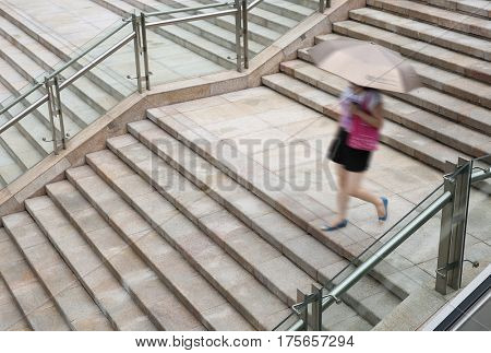 Young adult woman walking Down the stairs