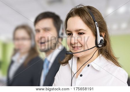Telemarketing and customer service concept. Young smiling woman in call centre.