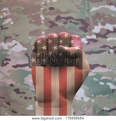 USA Clenched Fist on Camouflage Background  3D Render