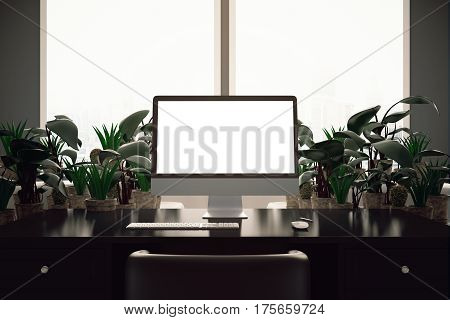 Backlit workplace with blank white computer screen and decorative plants. Mock up 3D Rendering