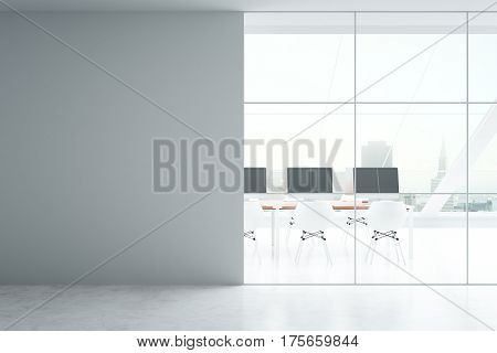 Blank concrete wall in modern coworking office interior with equipment city view and daylight. Mock up 3D Rendering