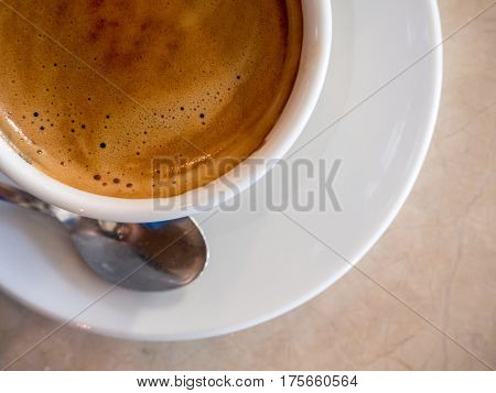 top view of coffee in white cup