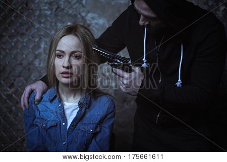 Is this the end. Dreaded murderous brutal criminal threatening a woman with a gun while she not being scared of him